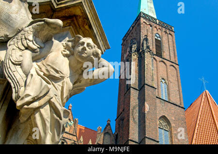 Wroclaw, Silesia, Poland. Church of the Holy Cross and St Bartholemew; angel at base of the statue of St John Nepomuk - Stock Photo