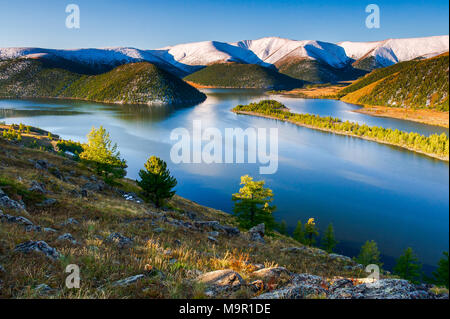 Lake Shireet with snow-covered mountains, Mongolia - Stock Photo