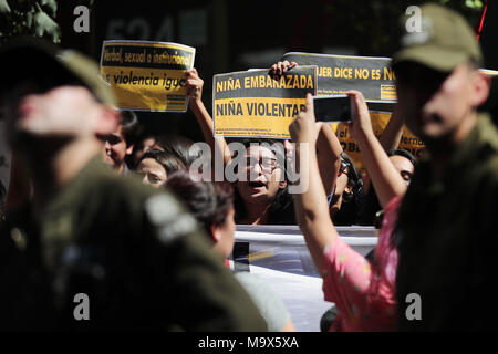 Santiago, Chile. 28th Mar, 2018. A group of women demonstrates in front of the Ministry of Health in Santiago, Chile, 28 March 2018. Dozens of women protested in rejection of the decision of the Chilean government that modified the 'protocol of conscientious objection', to allow institutions that refuse to perform abortions continue receiving contributions from the State. Credit: Mario Ruiz/EFE/Alamy Live News - Stock Photo