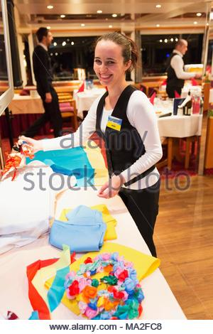 A Danube cruise on the MS Wolga: Captain's Dinner being prepared in the dining room - Stock Photo
