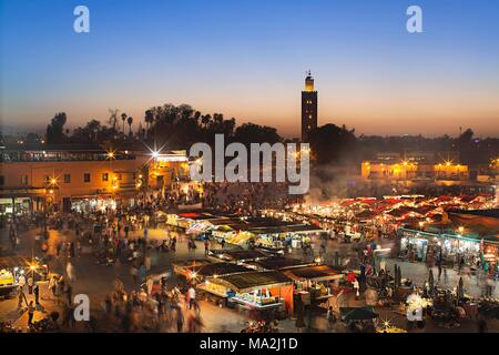 The Jamaa el Fna market place, World Heritage site, in the evening, Marrakesh, Morocco - Stock Photo