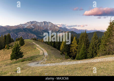 View of the Presolana during an autumnal sunset from Monte Pora, Val Seriana, Bergamo district, Lombardy, Italy. - Stock Photo