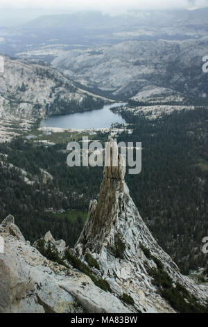 View from Cathedral Peak, the lightning rod of Yosemite National Park with a stunning view overlooking the landscape and a storm coming. Pinnacle in t - Stock Photo