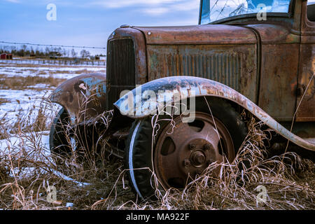 Beautiful Form of an Old Car in the Field During Winter - Stock Photo