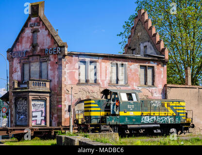 Derelict Brasserie Au Petit Rhin, ruined house, fire damage, burned out roof framework, train diesel locomotive, Strasbourg, Alsace, France, Europe, - Stock Photo