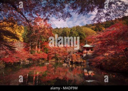 Beautiful reflective pond in front of Bentendo Hall in a colorful autumn scenery at Daigo-ji temple, Shimo-Daigo part of Daigoji complex in Fushimi-ku - Stock Photo