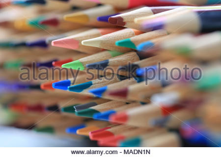 Extreme closeup of sharp colored pencils that are stacked and lined-up and have not been used. Concept for art class or being ready for school. - Stock Photo
