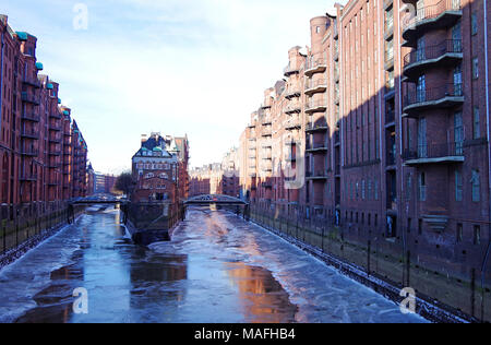 View along the Wandrahmsfleet, Speicherstadt, the historic port area of Hamburg, lined with Gothic revival warehouses of late 19th early 20th Century - Stock Photo