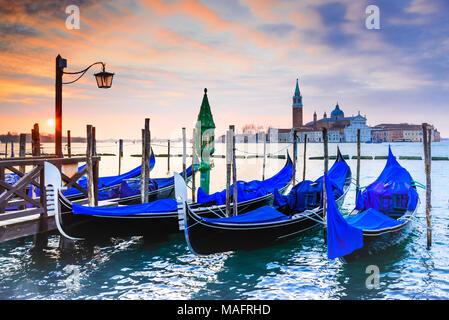 Venice, Italy. Sunrise with Gondolas on Grand Canal, Piazza San Marco, Adriatic Sea. - Stock Photo