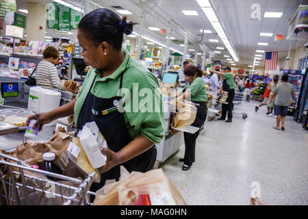 Miami Beach Florida Publix Super Market supermarket grocery store business shopping groceries checkout lane Black woman cashier - Stock Photo