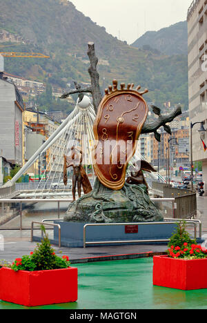 Cityscape with bronze sculpture 'Nobility of Time', located on shopping street in capital city. Andorra la Vella, Andorra - Stock Photo