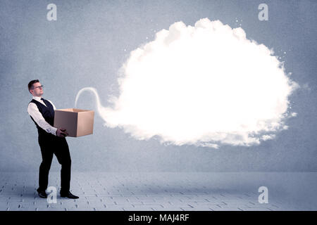 A young cheerful business person holding a cardboard box with illustration of white empty cloud concept. - Stock Photo