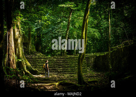 Adventure travel in jungle ruins with woman traveller - Stock Photo