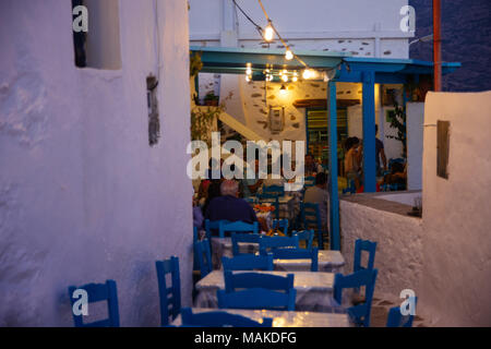 Amorgos, Greece-2 August 2017.People eating at a traditional Greek tavern in Lagada of Amorgos - Stock Photo