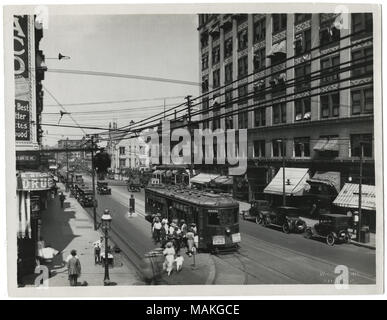 Title: Passengers boarding and debarking from Grand Avenue Car No. 23, approaching Grand and Olive.  . 1921. W.C. Persons - Stock Photo