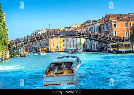 Boat Colorful Ponte dell Academia Bridge  Ferry Docks Touirists Grand Canal Venice Italy - Stock Photo