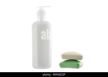 Bottle of liquid soap and two bars of soap isolated on white background. Healthcare concept. - Stock Photo