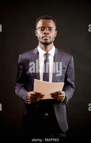 close up shot of teacher examiming his students and holding empty sheets - Stock Photo