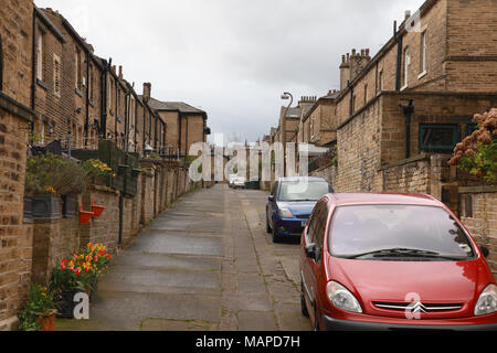 Back to back terraced houses built before the invention of the motor car in the  Victorian model village of Saltaire, Yorkshire - Stock Photo