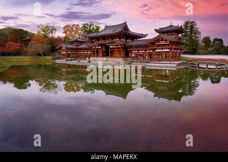 Peaceful autumn scenery of the Phoenix Hall, Amida hall of Byodoin temple on Kojima island of Jodoshiki teien, Pure Land garden pond. Uji, Kyoto Prefe - Stock Photo