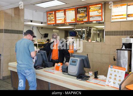 Man buying a whataburger, interior of a Whataburger burger store, Austin, Texas USA - Stock Photo