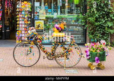 A bicycle outside a shop in Amsterdam, Netherlands, Europe - Stock Photo