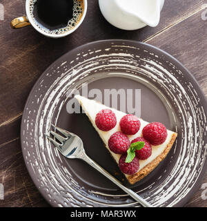 Cheesecake with raspberries, coffee and cream. Top view, square crop - Stock Photo