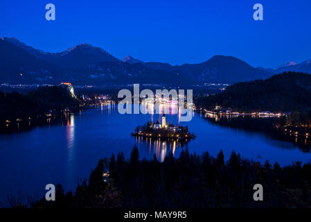 Lake Bled and the church in Slovenia at evening - Stock Photo