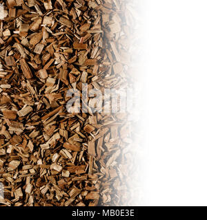 Dark brown wood chips create abstract rough-textured organic background surface - Stock Photo