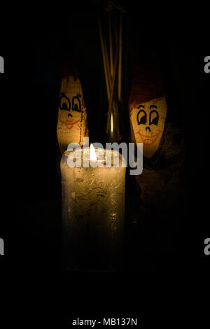 wooden dwarf in candle light - Stock Photo
