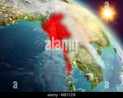 Sunrise above Myanmar highlighted in red on model of planet Earth in space. 3D illustration. Elements of this image furnished by NASA. - Stock Photo