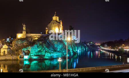 Night Evening Illuminated View Of The Metekhi Church And The Equestrian Statue Of King Vakhtang Gorgasali On The Metekhi Cliff In Old Historic Distric - Stock Photo