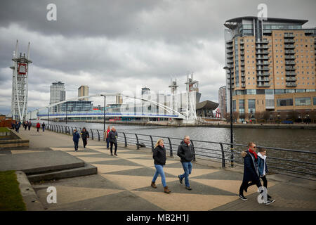 Manchester Ship Canal at Trafford Park Salford Quays, Manchester United football fans walking along the Trafford side to the match - Stock Photo