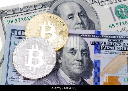 Golden and golden bitcoins on US dollars. Electronic money excha - Stock Photo