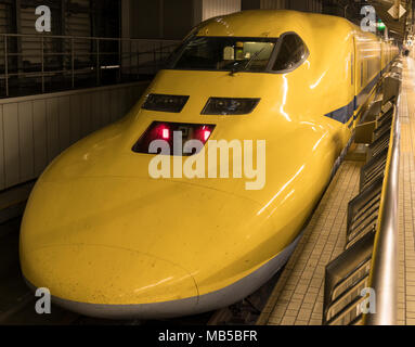 Japan Rail's Doctor Yellow, a special diagnostic Shinkansen train, at Tokyo Station. - Stock Photo