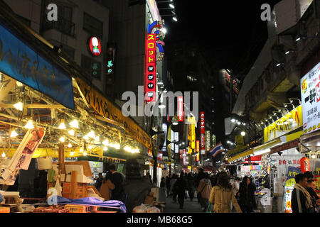 Translation: Ameyoko Shopping Street. The alleys around have food and other stalls. Taken in Tokyo, February 2018. - Stock Photo