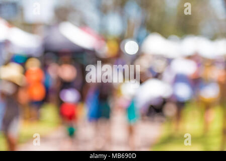 Blur abstract people background, unrecognizable silhouettes of people walking on outdoor festival fair. Food stall at day festival for background usag - Stock Photo