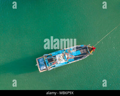 Top view. Aerial view from drone. Royalty high quality free stock footage of the fishing boat on the beach. Fishing boat is mooring on beach alone - Stock Photo