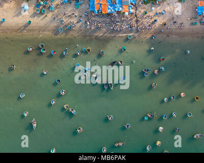 Top view. Aerial view fishing harbour market from drone. Royalty high quality free stock image of market at Mui Ne fishing harbour or fishing village - Stock Photo
