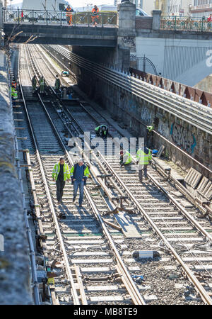 Railroad workers in metro channel working on renovation, Vienna Austria 2-04-2018 - Stock Photo