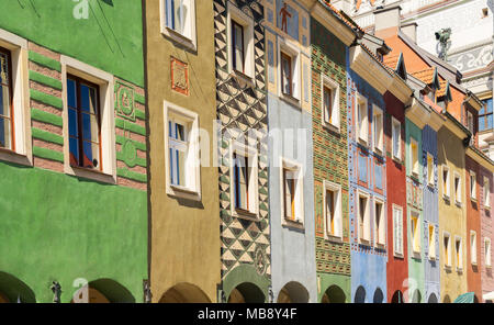 facades of colorful crooked medieval houses on the central market square in Poznan, Poland - Stock Photo