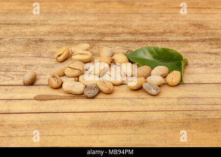 Coffee beans drying on sun on bamboo table outdoors. - Stock Photo