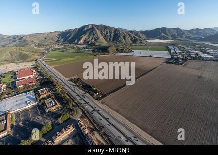 Aerial view of buildings, farm fields and Ventura 101 Freeway in Camarillo, California. - Stock Photo