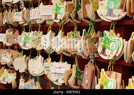 Translation: 'The wooden-plate prayer' ('ema') used in Japanese Shinto ritual at Tsurugaoka Hachimangu Shrine. Taken in Kanagawa, March 2018. - Stock Photo