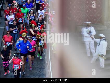 Prague, Czech Republic. 07th Apr, 2018. Runners (left) are seen on the race during the Prague Half Marathon in Prague, Czech Republic, on April 7, 2018. Credit: Roman Vondrous/CTK Photo/Alamy Live News - Stock Photo