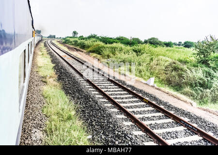 running train side view with railway track looking awesome. - Stock Photo