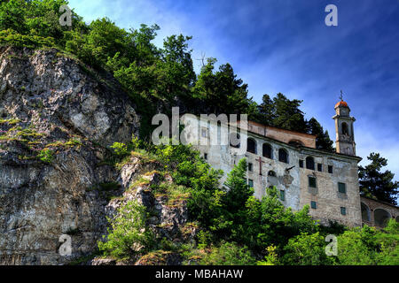 The sanctuary of Santa Lucia, partially in a rocky cave, at Villanova Mondovì, in Piedmont, Italy. - Stock Photo