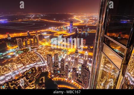 DUBAI, UAE - APR 14, 2013: Dubai downtown aerial view by night from highest skyscraper of the world Burj Khalifa, Dubai, United Arab Emirates - Stock Photo