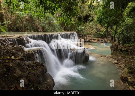 Beautiful view of a small waterfall at the Tat Kuang Si Waterfalls near Luang Prabang in Laos. - Stock Photo