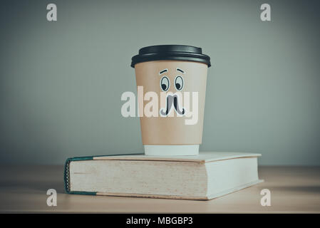 Cute cup of coffee and a book. - Stock Photo